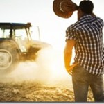 Farmer working in the fields with tractor.